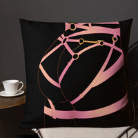 A pillow case featuring Acid Nova's Strappy Butt design. A black background with pink strappy lingerie worn on a pert bottom.