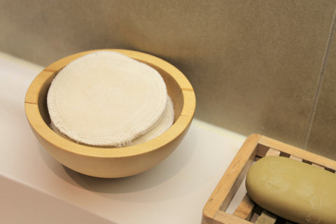 reusable makeup cotton pads in a container in the bathroom