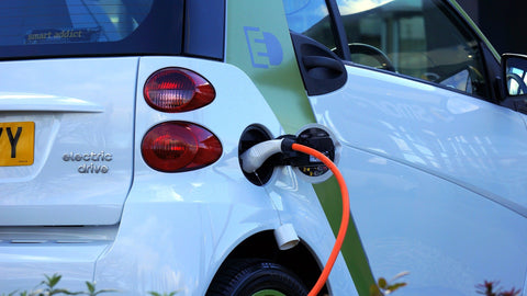 electric car being fuel by renewable energy