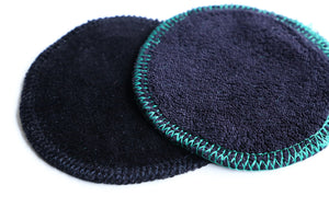 reusable makeup remover pads made with 100% organic cotton showing very close to the fabric black