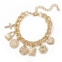 Load image into Gallery viewer, High polish bracelet with charms and lobster closure.