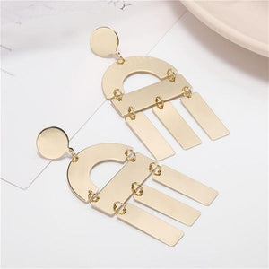 High polished earrings with drop embellishments.
