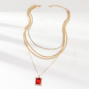 High polish layered chain with ruby pendant surrounded by rhinestones and a lobster closure