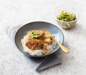 Chicken in peanut sauce with chilli-cucumber salad