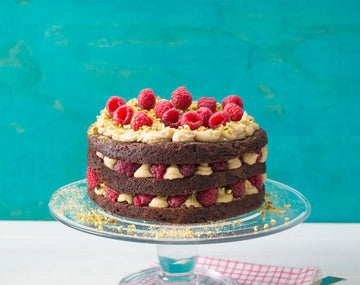 Vegan chocolate, raspberry and pistachio layer cake