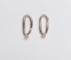 Oval earrings with White opals
