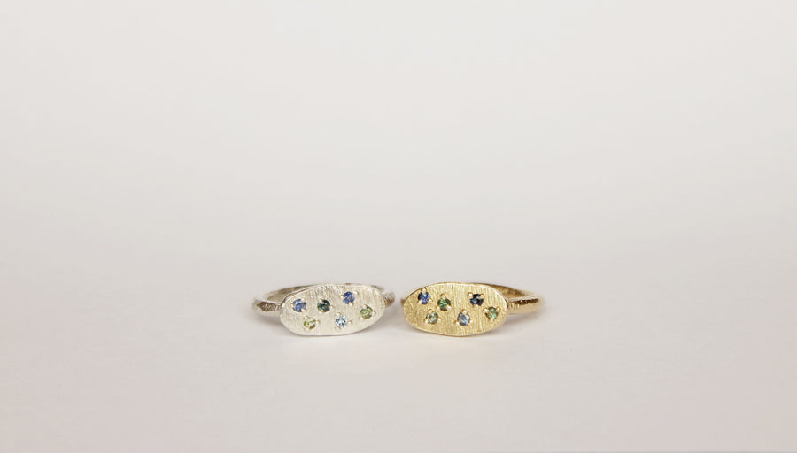 Silver oval ring with scattered sapphires
