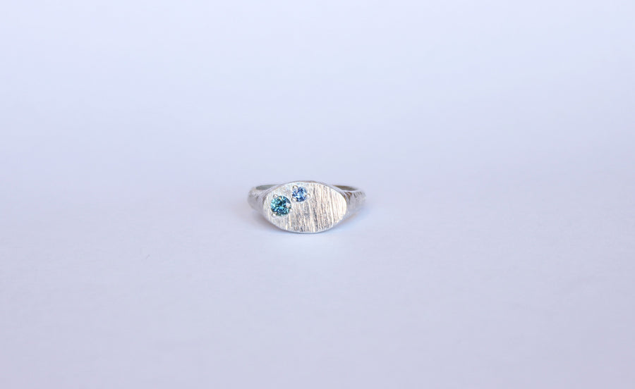 Silver signet ring with two sapphires