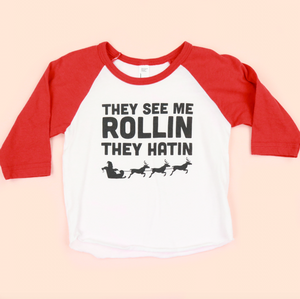 They See Me Rollin Christmas Kids Unisex Raglan