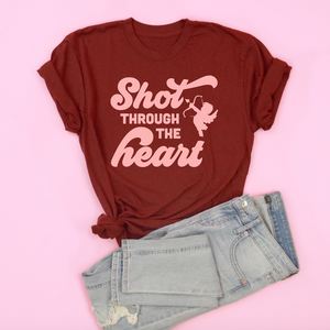 An image of the Shot Through the Heart Valentine's Day t-shirt with a pair of pants from Saturday Morning Pancakes.