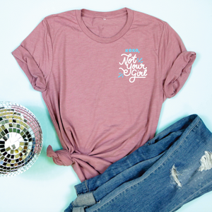 An image of the XOXO, Not Your Girl Valentine's Day t-shirt from Saturday Morning Pancakes styled with pants and a disco ball.