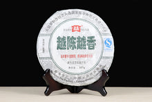 "Load image into Gallery viewer, 2009 DaYi ""Yue Chen Yue Xiang"" (The Older The Better) Cake 357g Puerh Sheng Cha Raw Tea"