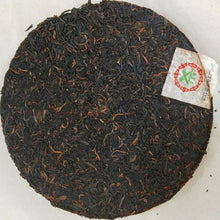 "Load image into Gallery viewer, 2003 XiaGuan ""8653"" Iron Cake 357g Puerh Raw Tea Sheng Cha - King Tea Mall"
