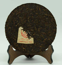 "Load image into Gallery viewer, 2007 XiaGuan ""T8653"" Iron Cake 357g Puerh Raw Tea Sheng Cha - King Tea Mall"
