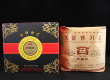 "Load image into Gallery viewer, 2012 DaYi ""Jin Zhen Bai Lian"" (Golden Needle White Lotus) Cake 357g Puerh Shou Cha Ripe Tea - King Tea Mall"