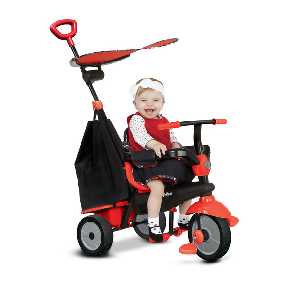 child on red smartrike delight 3 in 1 tricycle