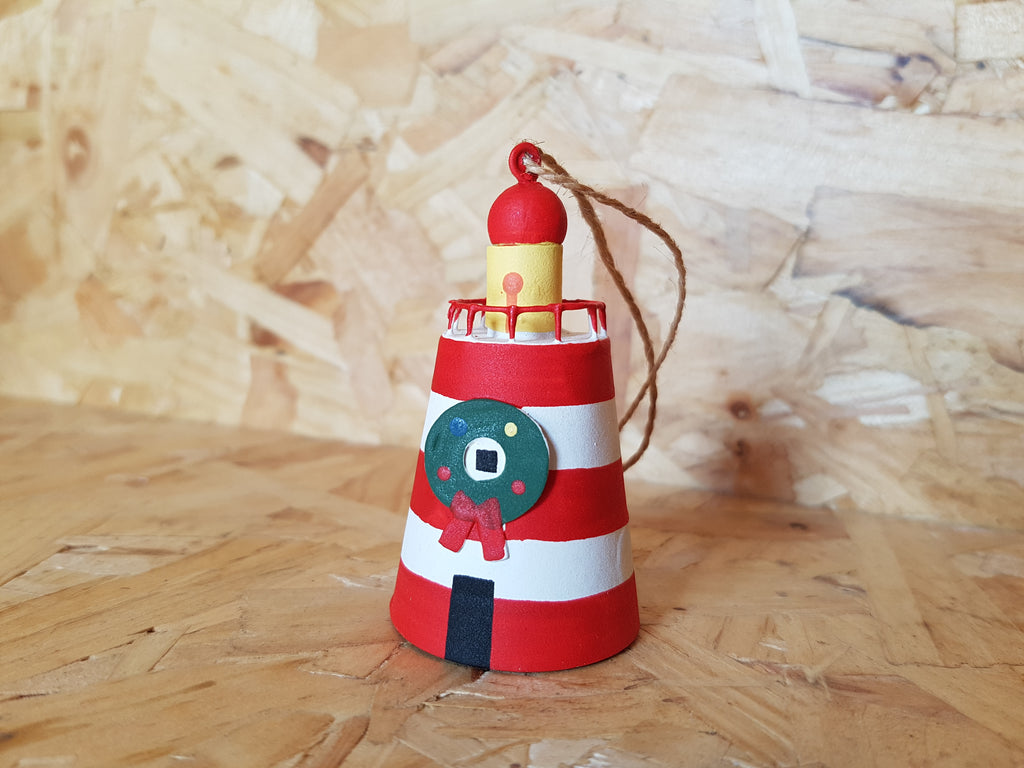 Red Lighthouse With Wreath Picture