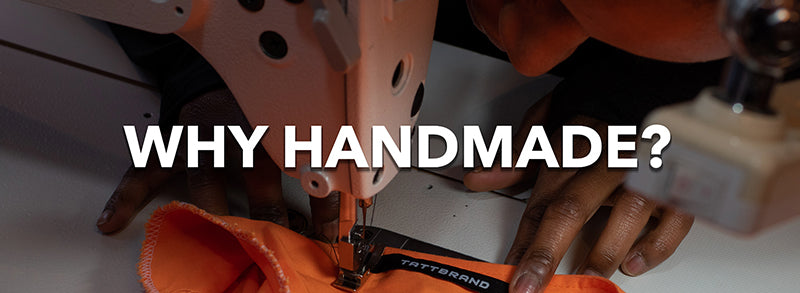 Owner Tatiana Fonjah sewing Tattbrand's necklabel in place on her orange Unique Vibe Blazer