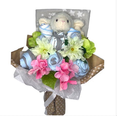 Amazing set of newborn clothes for a boy set in a bouquet arrangement with a cute Lamb