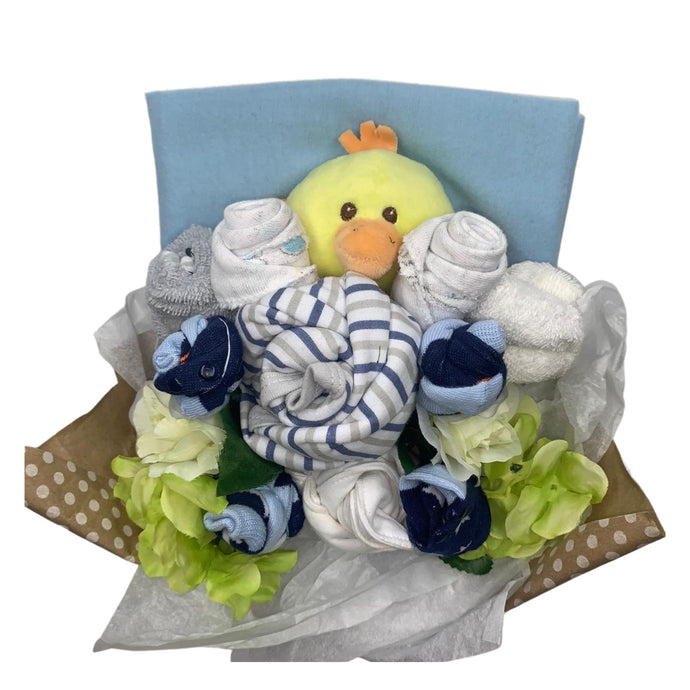 Beautiful baby items presented like a bouquet of flowers.  This baby boy bouquet contains