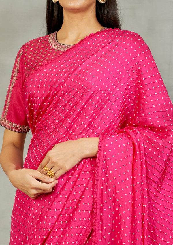 Fuschia bandhani silk saree with a frill edging