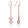 Rose Gold and Ruby Cross Dangle Earrings