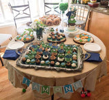 frogs, snails, and puppy dog tails themed dessert table for a first birthday party