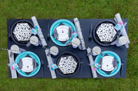Puppy themed table setting with black and white puppy cups and puppy plates for puppy birthday party