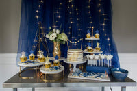 Out of This World Baby Shower Dessert Table. Space themed baby shower dessert table with gold leaf naked cake.