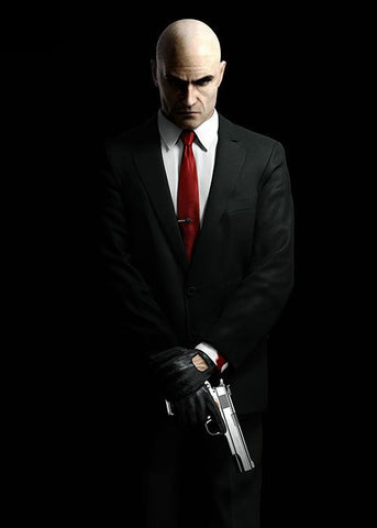 Hitman standing with a gun in his hands in black suit and red tie