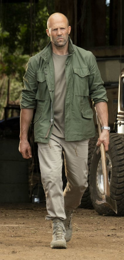 JASON STATHAM in green jacket holding an ax