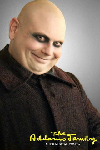 Uncle Fester from Addams Family with white face and dark undereyes