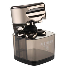 a Platinum Shaver By Skull Shaver put in a Rinse stand