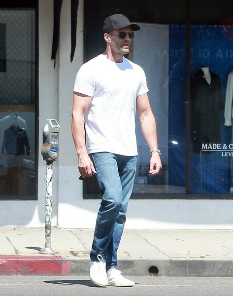 JASON STATHAM in white shirt, jeans, cap and sunglasses walking in the street