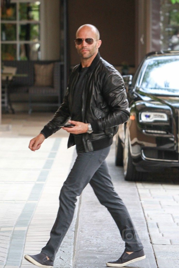 JASON STATHAM walking in the streets in leather jacket and fashion sunglasses