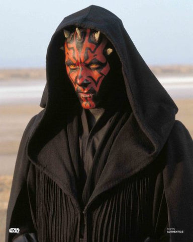 Darth Maul from Star Wars standing in black clothes and red mask