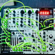 Eurorack modular synth with glow in the dark cables