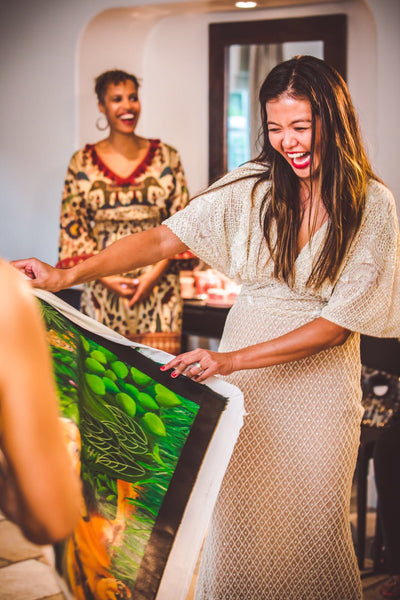 A happy client in the USA opening her gift, a commissioned acrylic painting by Reetesh Pitroli