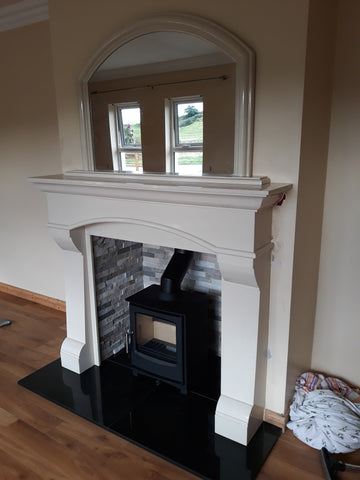 Gallery of stoves in a fireplace surround