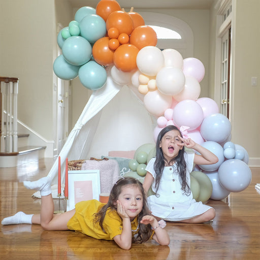 fall balloon garland with kids by shimmer and confetti