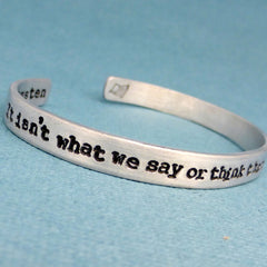 Sense & Sensibility - It isn't what we say or think that defines us, but what we do - A Double-Sided Hand Stamped Aluminum Bracelet
