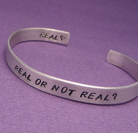 Hunger Games Inspired - Real Or Not Real - A Double Sided Hand Stamped Aluminum Bracelet