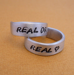 Hunger Games Inspired - Real or Not Real and Real - A Pair of Hand Stamped Aluminum Rings
