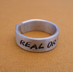 Hunger Games Inspired - Real Or Not Real - A Hand Stamped Aluminum Ring