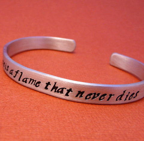 Les Miserables Inspired - There Is A Flame That Never Dies - A Hand Stamped Bracelet in Aluminum or Sterling Silver