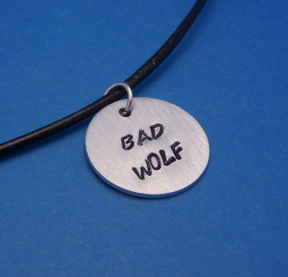 Doctor Who Inspired -  Bad Wolf - A Hand Stamped Aluminum Disc Necklace