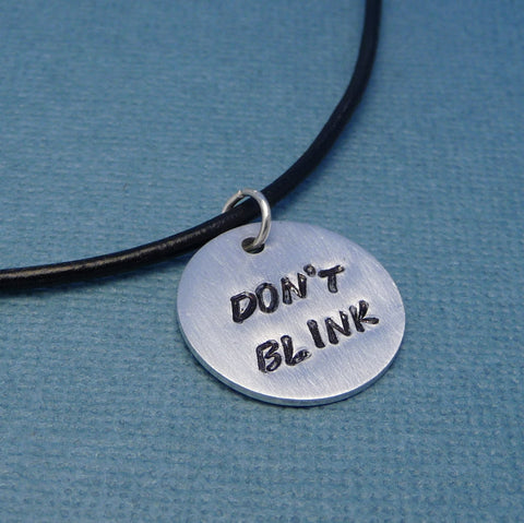 Doctor Who Inspired -  Don't Blink - A Hand Stamped Aluminum Disc Necklace