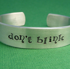 Doctor Who Inspired - Don't Blink - A Hand Stamped Aluminum Bracelet