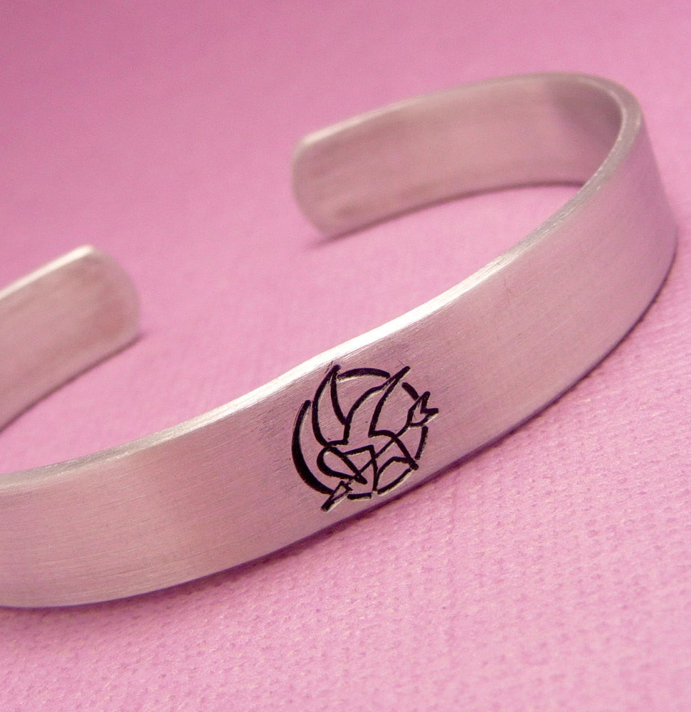 Hunger Games Inspired - Mockingjay Symbol - A Hand Stamped Aluminum Cuff Bracelet
