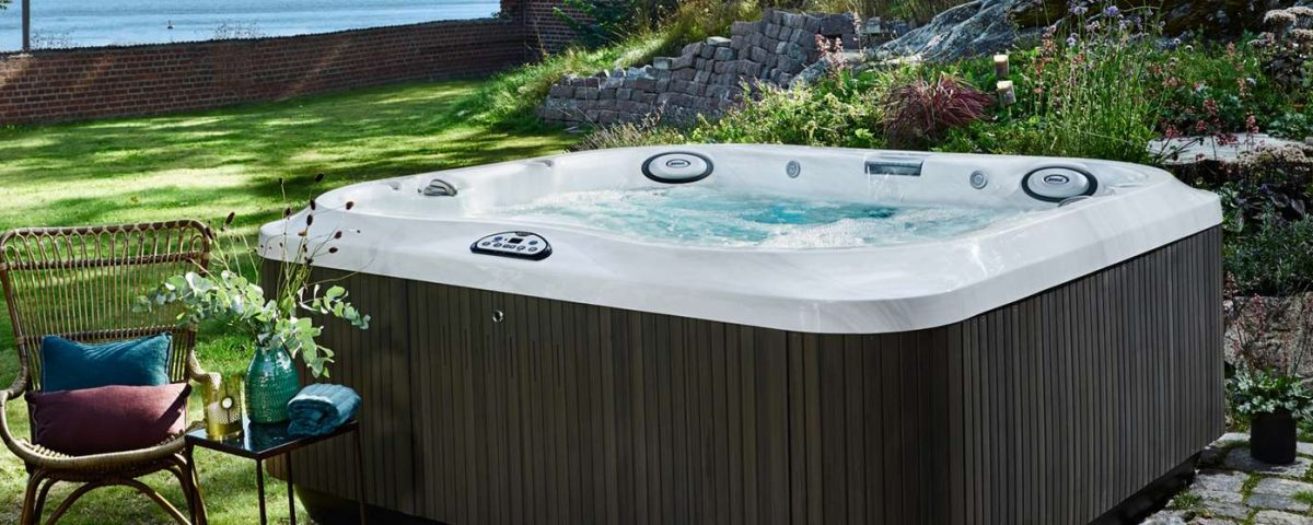 Jacuzzi j-300 hot tub in grassy yard